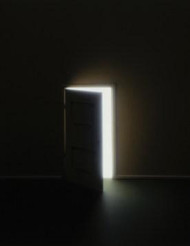 Door opening in darkness, revealing light