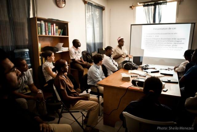 Health workers watch presentation