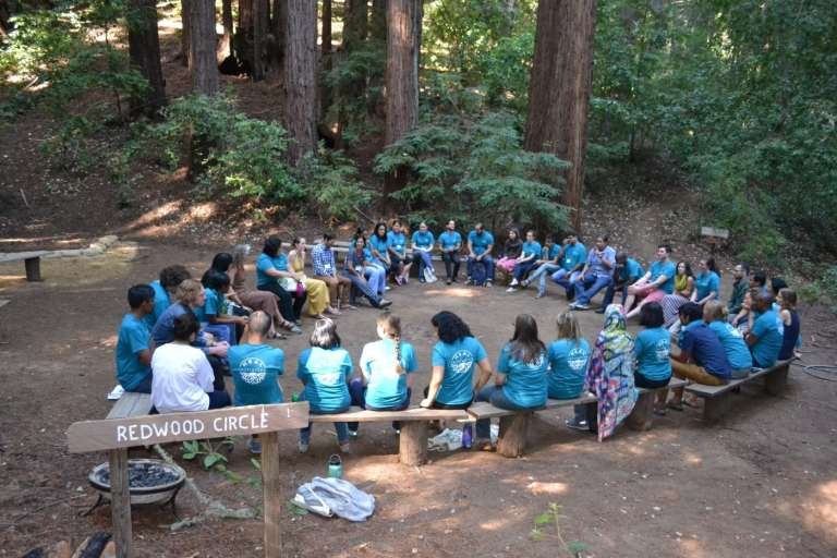 HEAL fellows sit in a circle in the redwoods