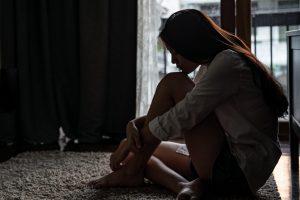 Depressed girl in dark room