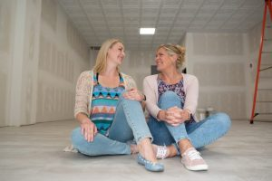 The co-owners of the Topeka Yoga Network, Evelyn Spangler, left, and Mary Boland are sitting in the front of the store on Wednesday morning, which will soon be their stationary yoga studio.
