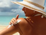 Women putting on Sunscreen