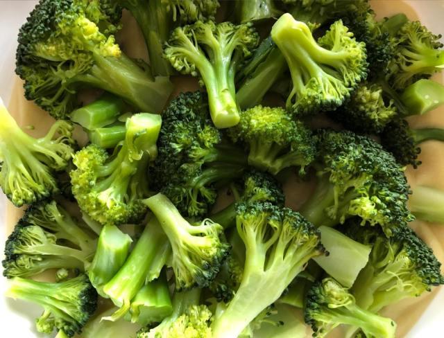 Steamed broccoli over sauce Broccoli Cauliflower Casserole