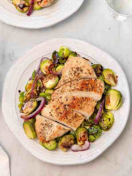 Super tender sheet pan chicken with crispy balsamic glazed brussel sprouts - recipe by Healthful Blondie