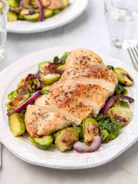 Healthy chicken and balsamic brussels made on one pan in 25 minutes - recipe by Healthful Blondie