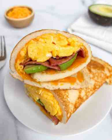Loaded breakfast burrito. This healthy bacon egg and cheese has creamy avocado and is wrapped in a fluffy pancake. Gluten free, protein loaded, and no sugar!
