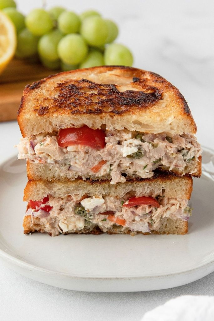 Up close shot of healthy Mediterranean tuna melt sandwich with feta cheese on crisp toasted bread.