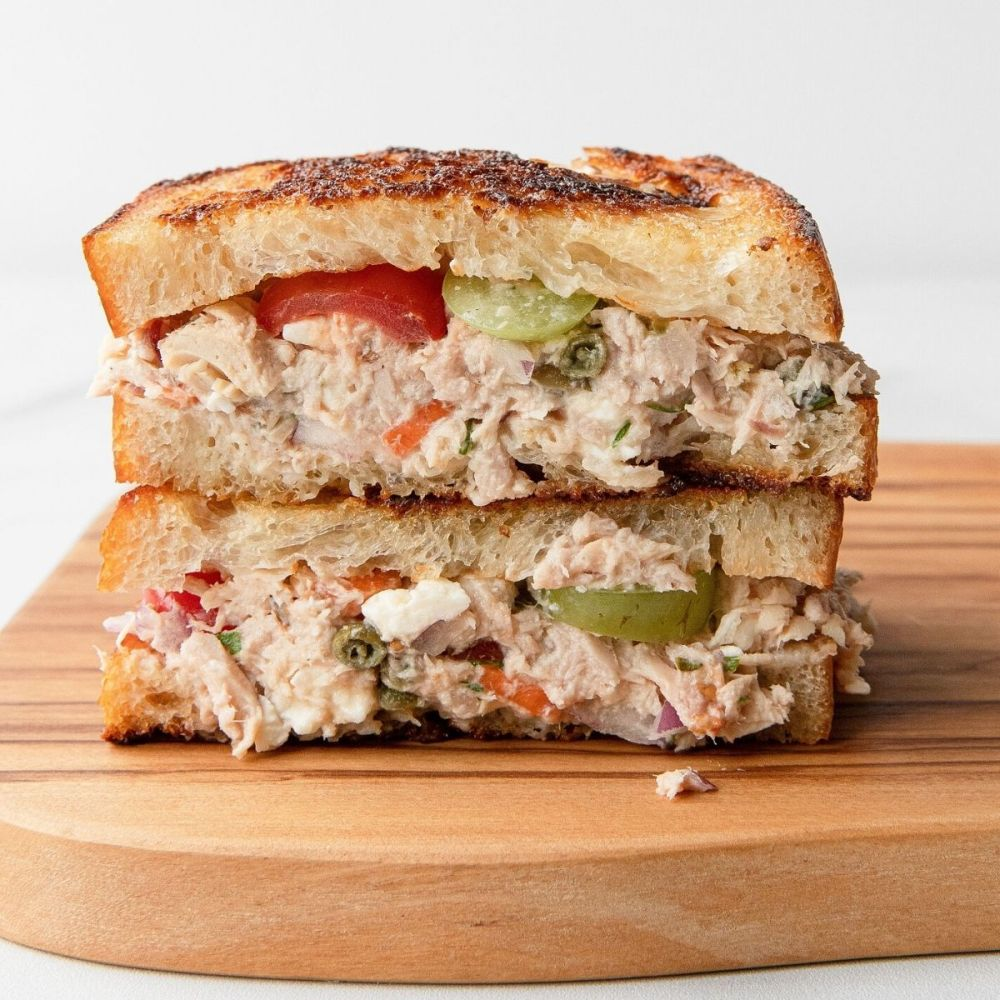 Healthy Mediterranean tuna melt sandwich with crispy toasted sourdough bread.