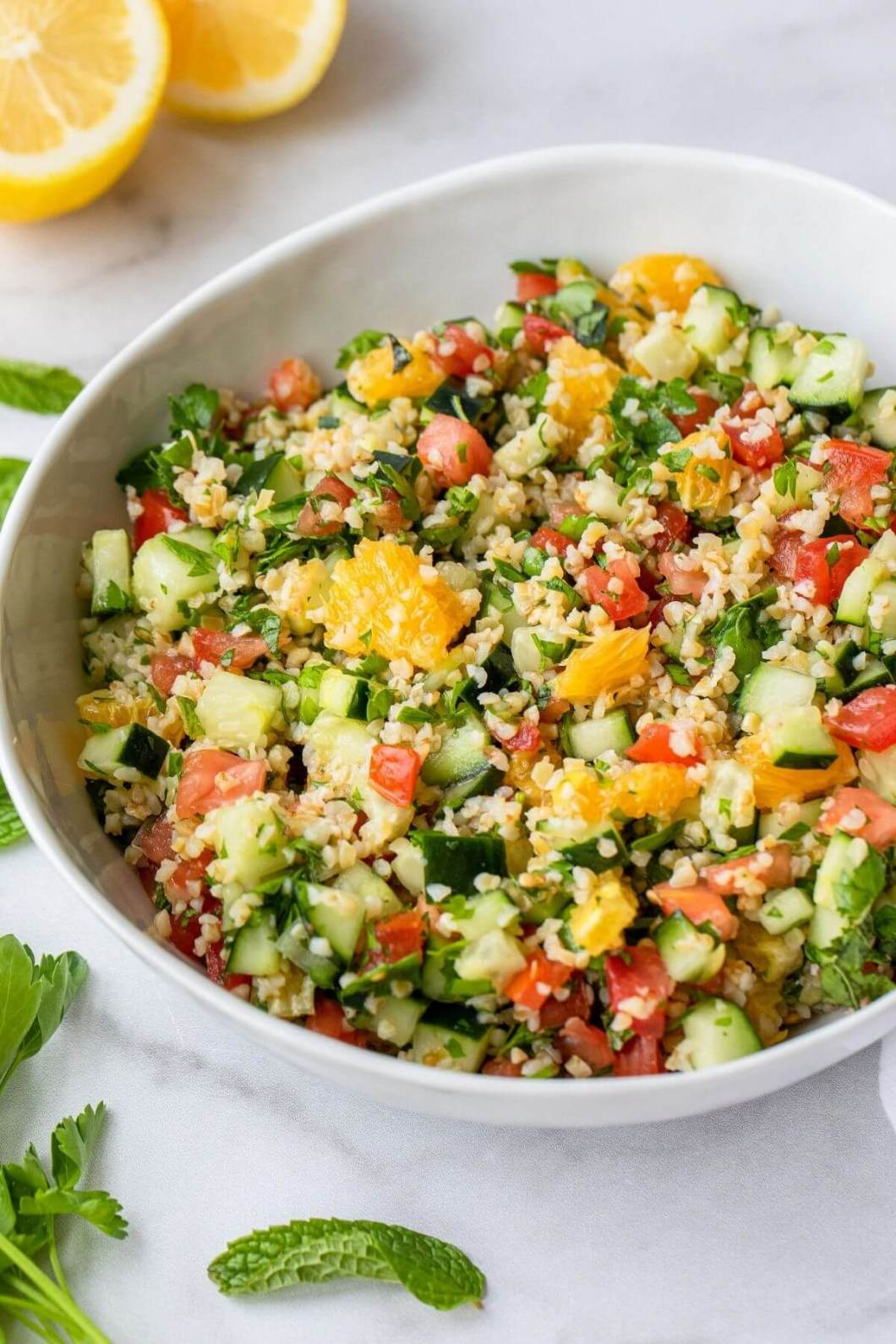 close up of healthy Mediterranean tabbouleh salad with citrus to shot texture