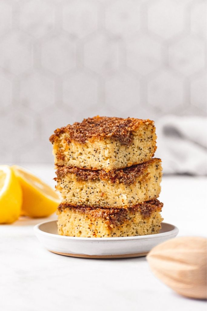 three pieces of healthy lemon poppy seed cake stacked on top of each other