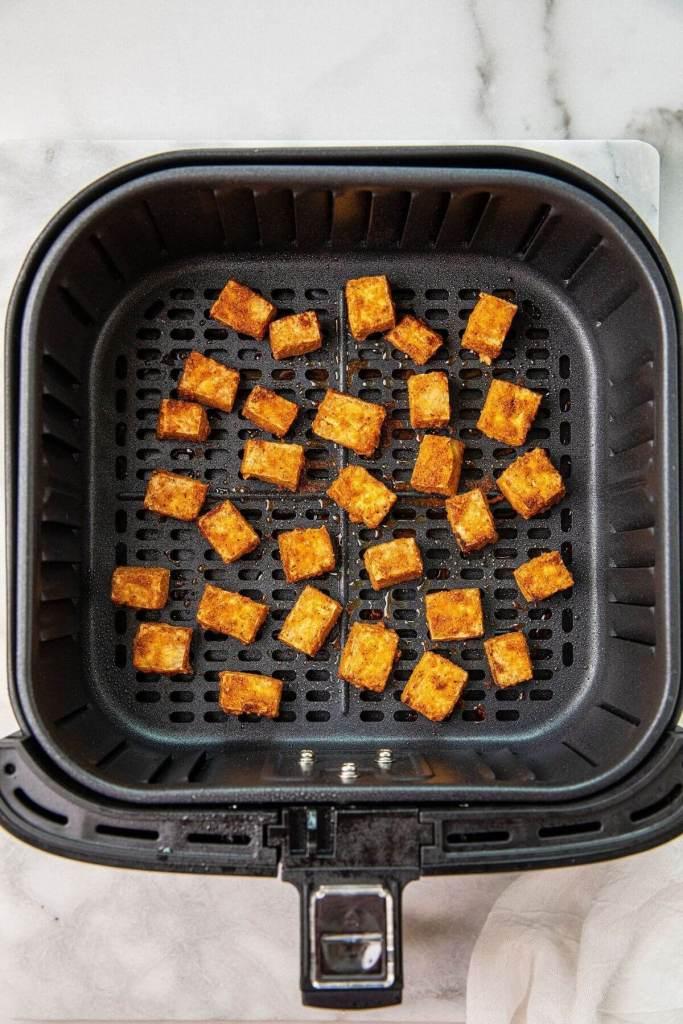 air fried crispy tofu in air fryer basket