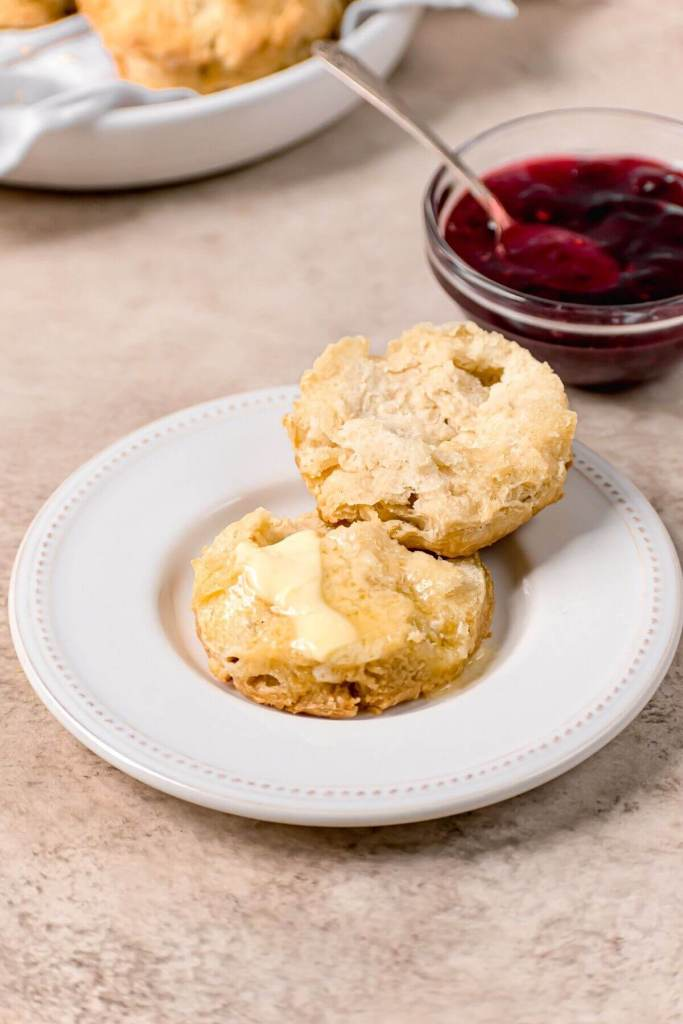 fluffy buttermilk biscuit cut open with melted butter