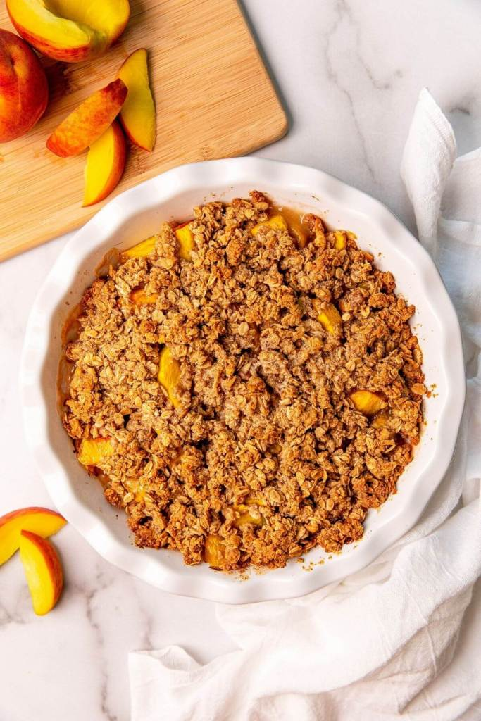 healthy peach crisp with buttery oat crumble topping