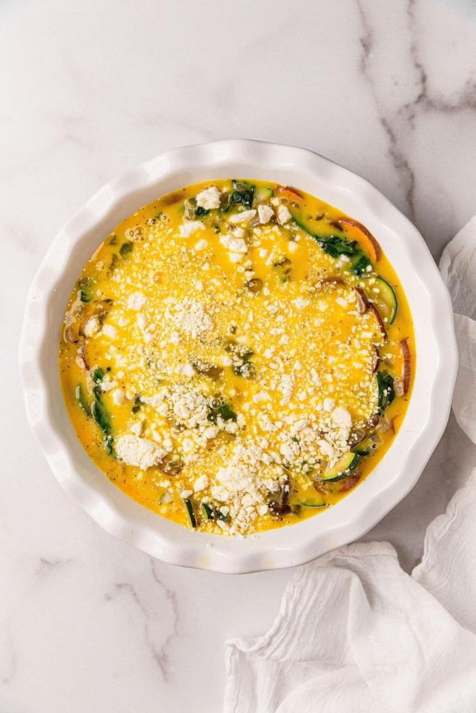 sprinkled feta on top of crustless healthy quiche