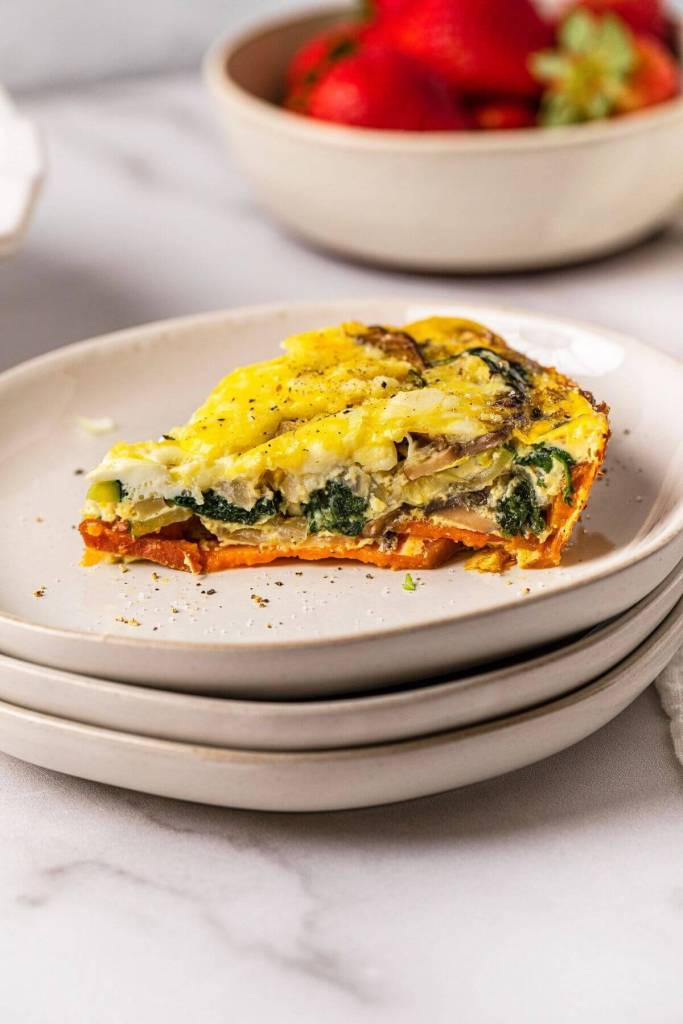 slice of vegetable quiche with a sweet potato crust