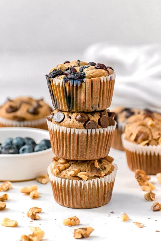 three blender baked oatmeal muffins stacked on top of each other