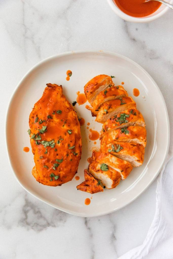 two air fried buffalo chicken on a plate