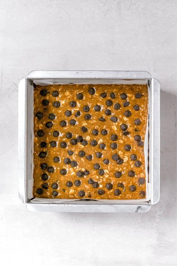 oatmeal pumpkin bar batter in a pan before baking