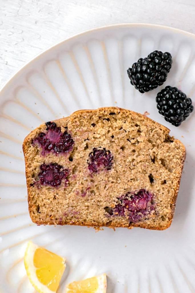 slice of blackberry lemon bread on a plate