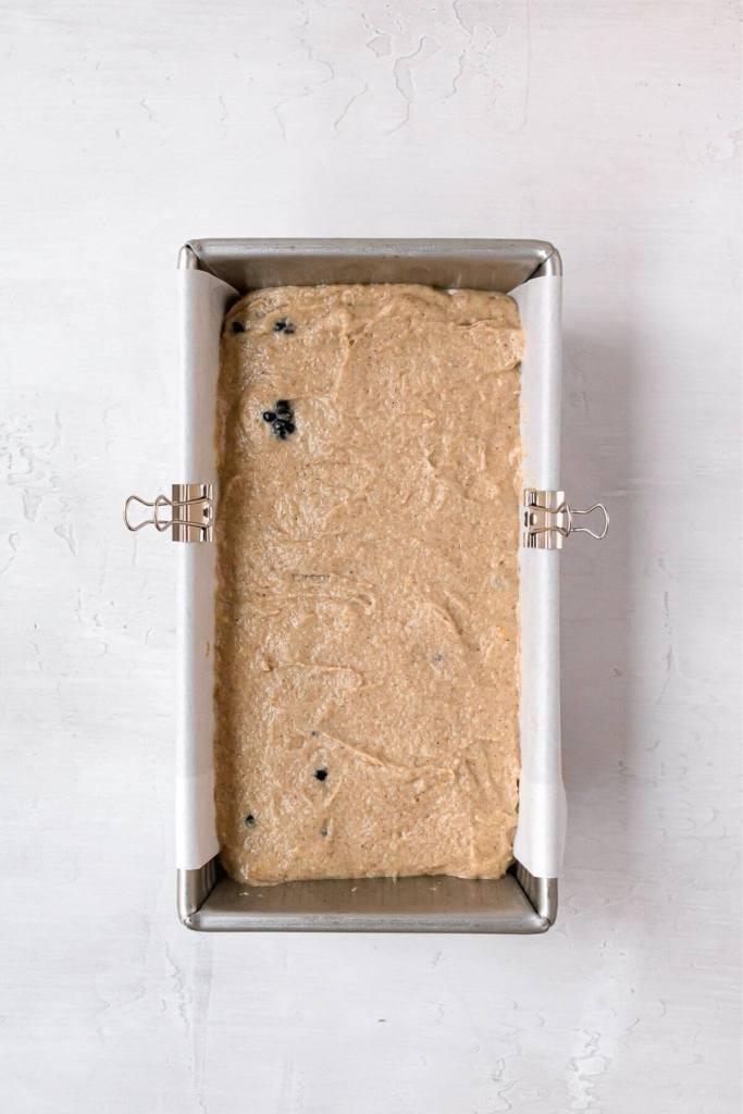 lemon blackberry batter in a bread tin