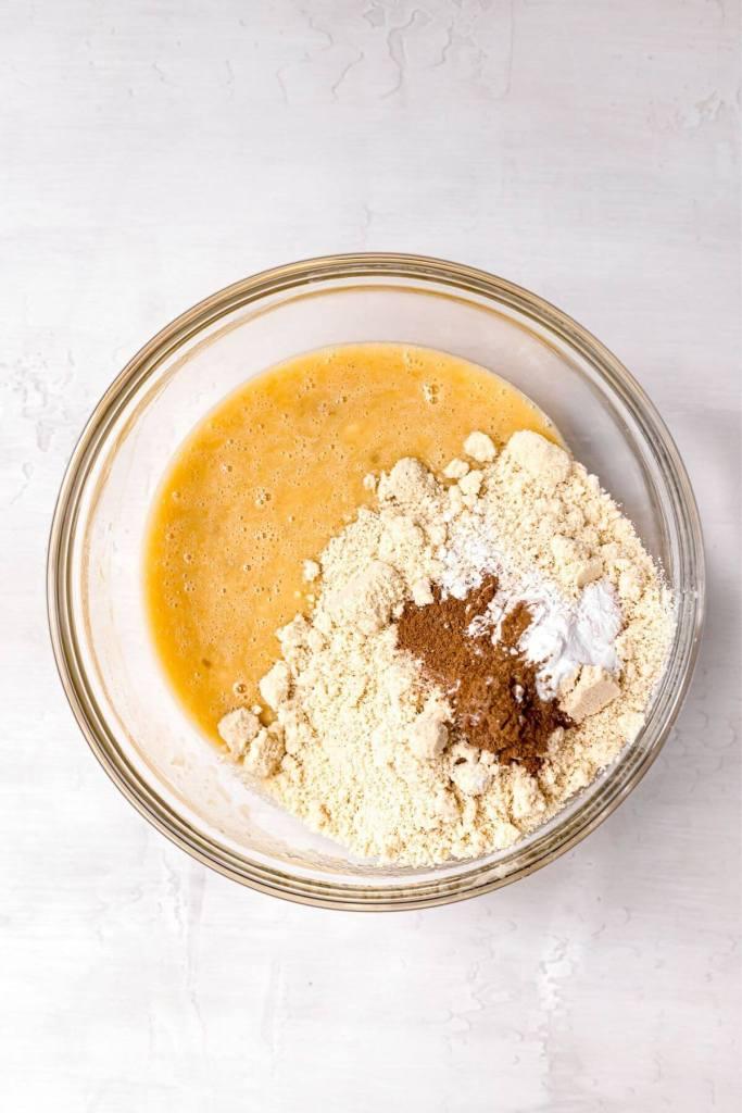 adding almond flour to banana muffin batter