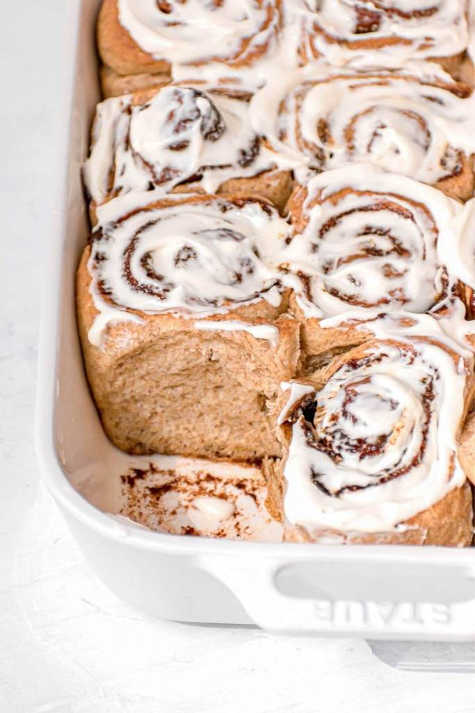 cinnamon rolls in a pan with icing