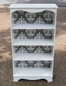 Learn how to turn on old, ugly bookcase into this.  Step-by-step guide.