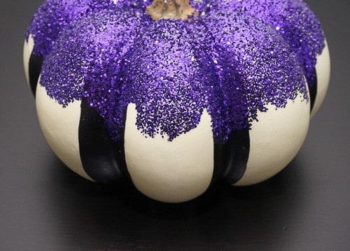 This glitter pumpkin was so easy to make, and it turned out so cute. It's a unique and fun addition to your Halloween decor.