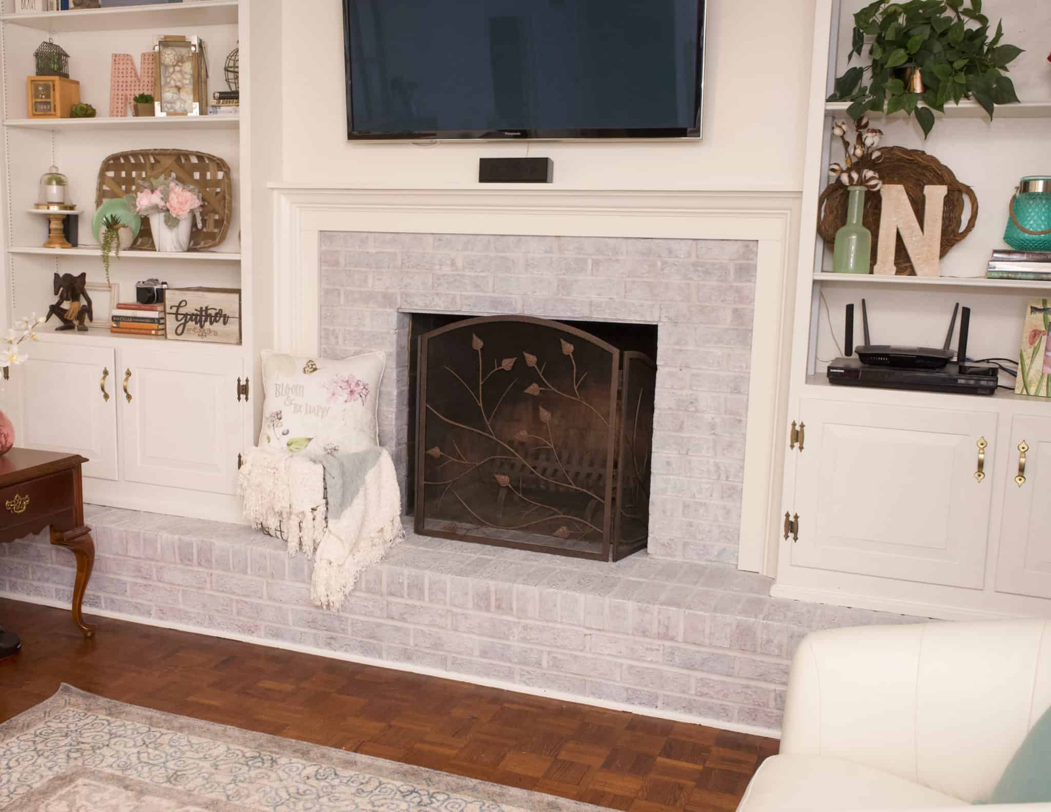 Do you love the look of whitewashed brick? This tutorial will show you step by step how to whitewash your fireplace in order to update your home.