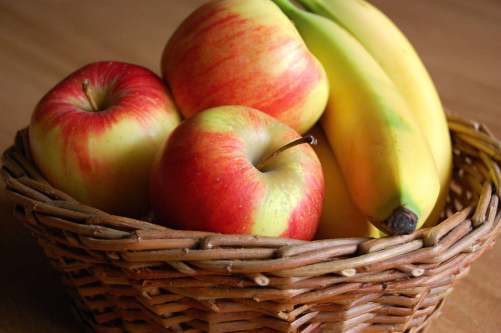 Basket of bananas and apples