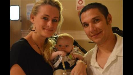 Alex and Anna Nikolayev with Baby
