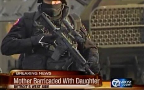 Photo taken from TV footage of the SWAT team sent to the home of Maryanne Godboldo
