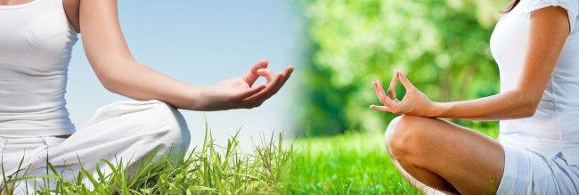 two girls practice yoga