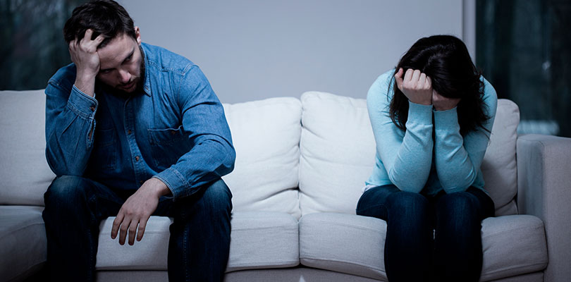 Image result for couple sitting on opposite ends of couch