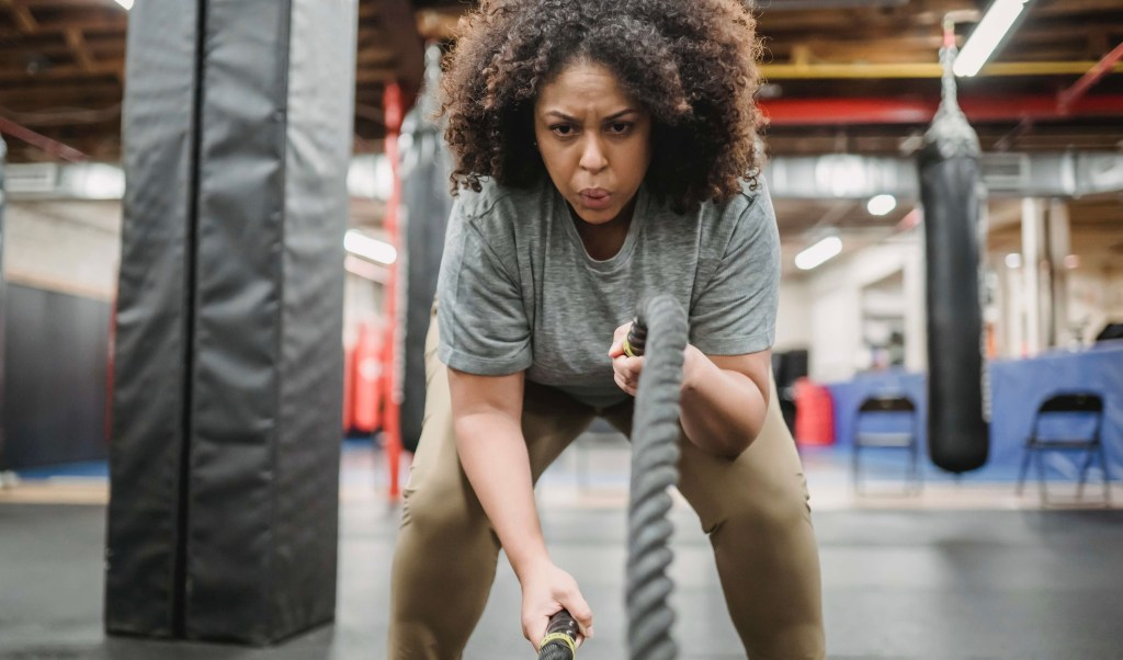 Girl with curls in a gym