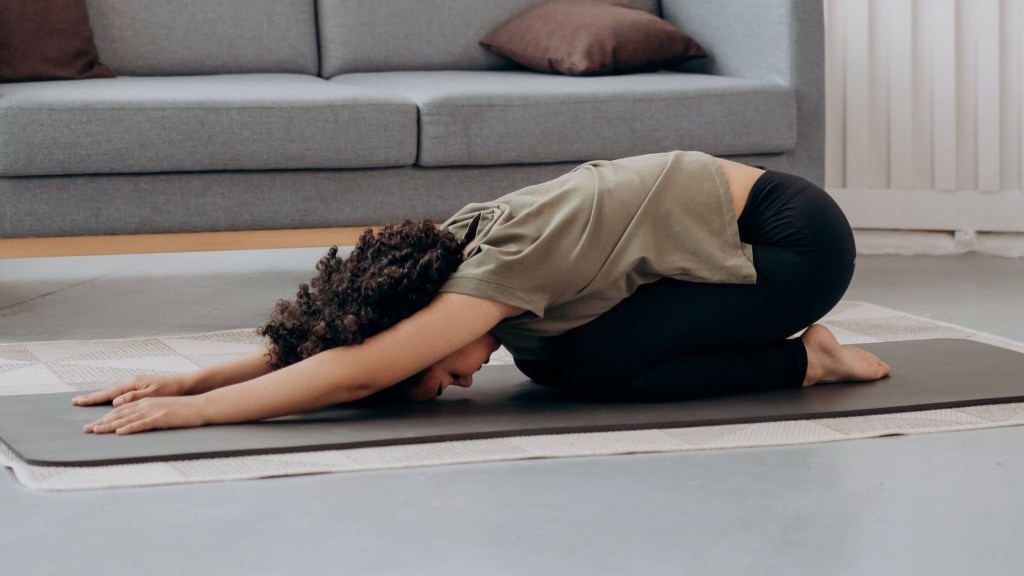 A Women doing stretches for Back pain