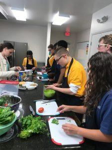 Students prepare taco bar.