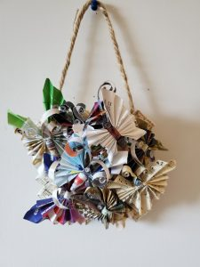A wall hanging made from greeting cards