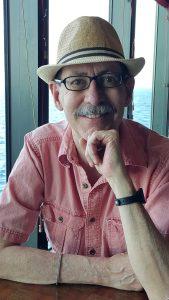John Linnell wearing a hat