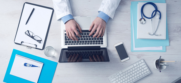 Doctor with computer 600x274