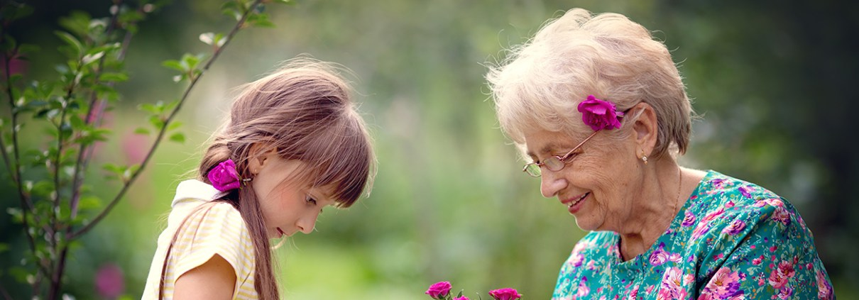 Older lady and girl gardening