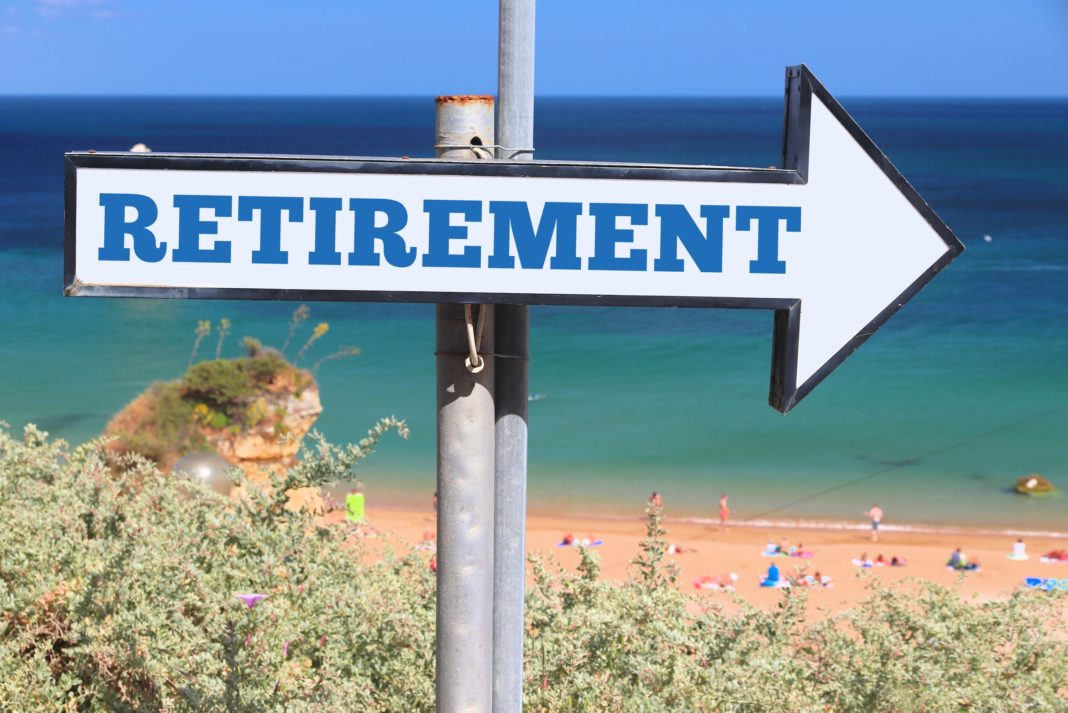 retirement-plan-arrow-sign-beach-1068x713
