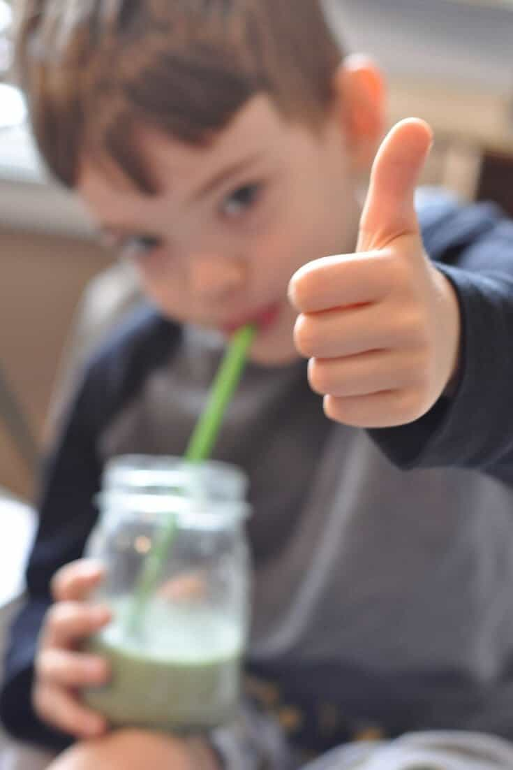 """Young child giving a """"thumbs up"""" sign for a traditional diet."""