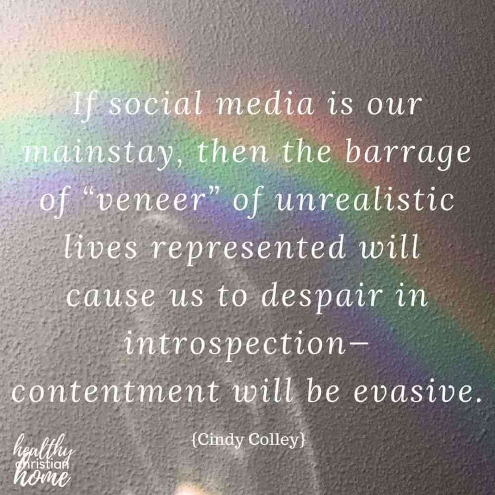 Quote about Christian contentment and social media on a background photograph of a rainbow.