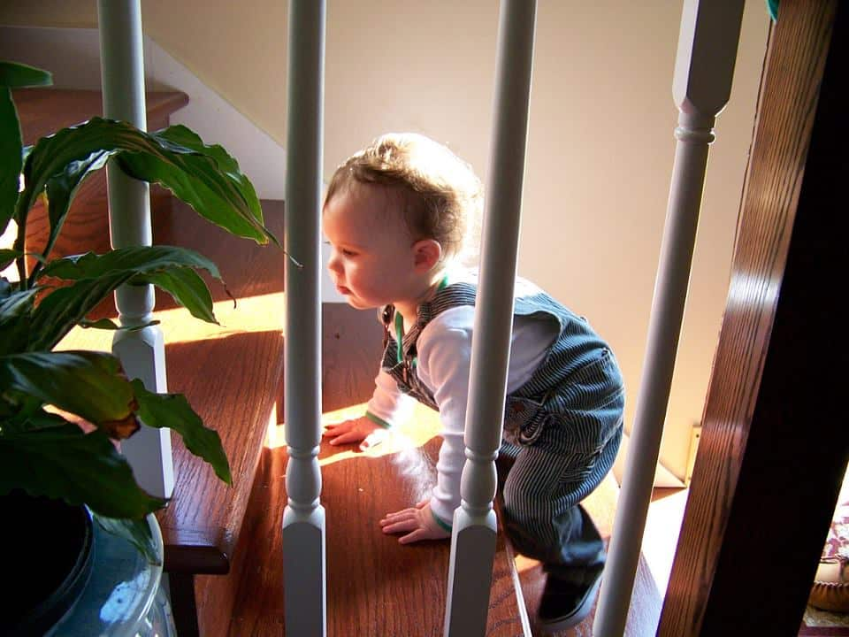 Baby climbing up a staircase