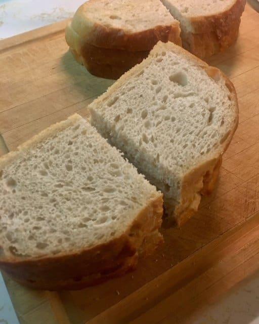 Sourdough bread cut in half for mini pizzas