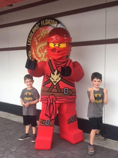 Two boys at Legoland with a Lego ninja