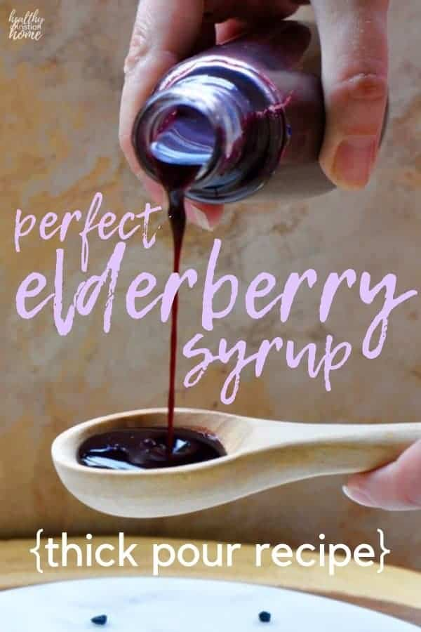 Elderberry syrup recipe text on top of a bottle of syrup being poured onto a spoon.