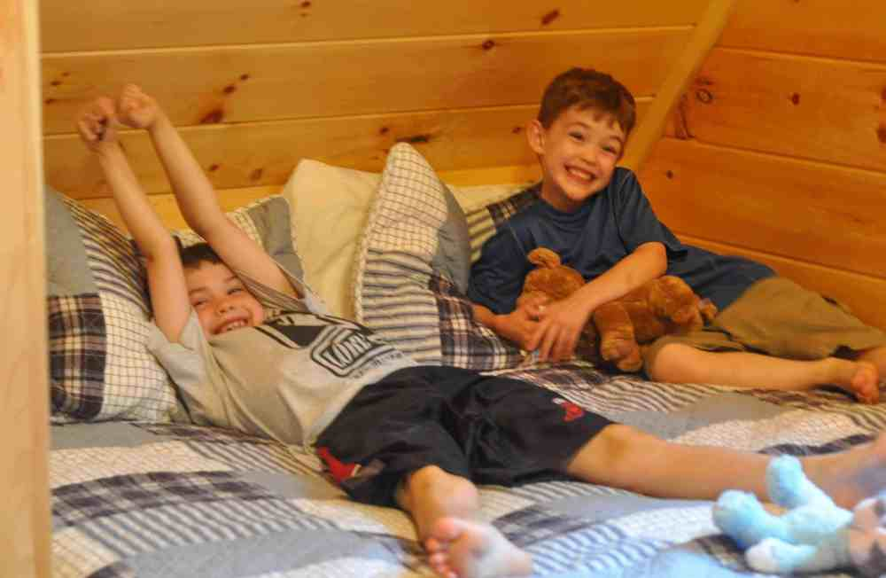 Two brothers in their nature for kids cabin loft.