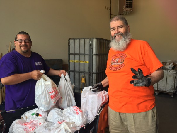 dick and another volunteer unloading donations